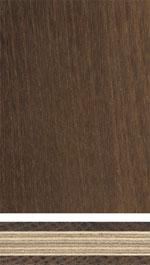 Composite panel with facing layer of thermal treated wood